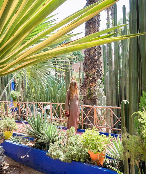 Chelsey Rouen at the Jardin Majorelle in Morocco